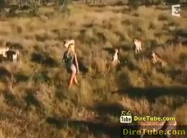 Hot Girl Playing with Cheetah